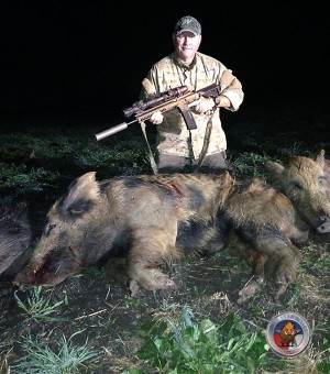 The Author with a Large, Tough, Trap Shy Hog Shot with the 6.8SPC.