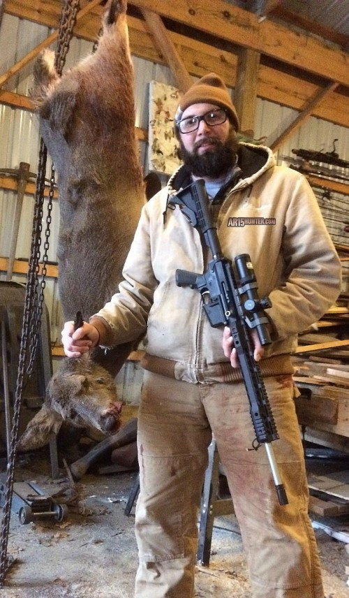He standing next to my prize with rifle in hand.